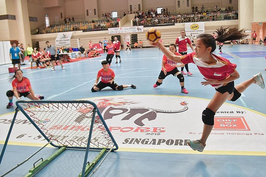 Singapore's Celine Sheum attempting to score against Chinese Taipei in the women's final of the Asia-Pacific Tchoukball Championships. The Republic finished runners-up after a 56-38 loss at Our Tampines Hub yesterday.