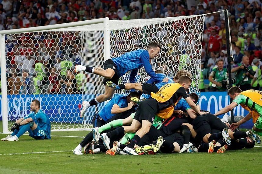 The entire Croatia squad piling on Ivan Rakitic after he scored the deciding penalty during the shoot-out. It is only the second time Croatia have reached the semi-finals of the World Cup. They finished third in France in 1998.