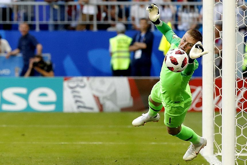 England goalkeeper Jordan Pickford flinging himself at Sweden striker Marcus Berg's goal-bound header early in the second half on Saturday. Had it not been for his heroics, Sweden would have equalised just after the break, but the Three Lions ran out