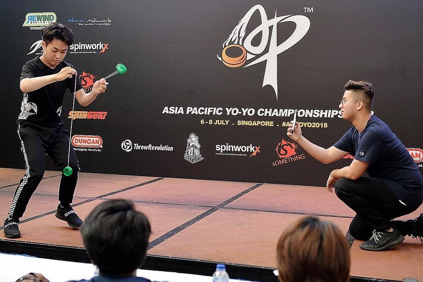 Champion of Champions Arata Imai (left) doing his tricks yesterday, with his performance recorded by Mr Thawrir Iqbal using a phone. The competition drew 161 competitors from 15 countries in the region.