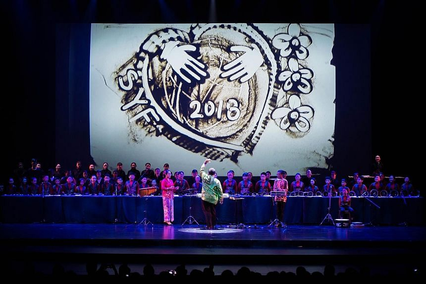 The Singapore Youth Festival concert on June 30 opened with a performance of sand art by Zhonghua Secondary students, with a musical backdrop with handbells performed by students with special needs from Grace Orchard School, and their peers from Guan