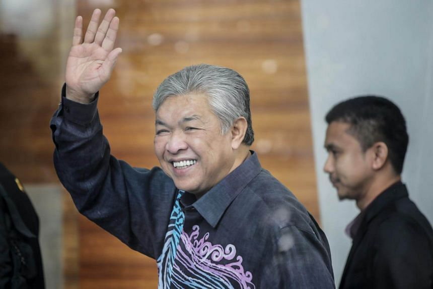 Datuk Seri Dr Ahmad Zahid Hamidi waving as he arrives at the Malaysia Anti-Corruption Commission in Putrajaya, Malaysia. He is almost certain to be the opposition leader when the new Parliament begins, on July 16, 2018.