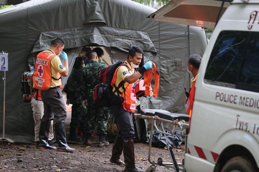 Military and police personnel at the quarantine tent in the Tham Luang cave area on July 8, 2018, after divers evacuated some of the boys who were trapped.