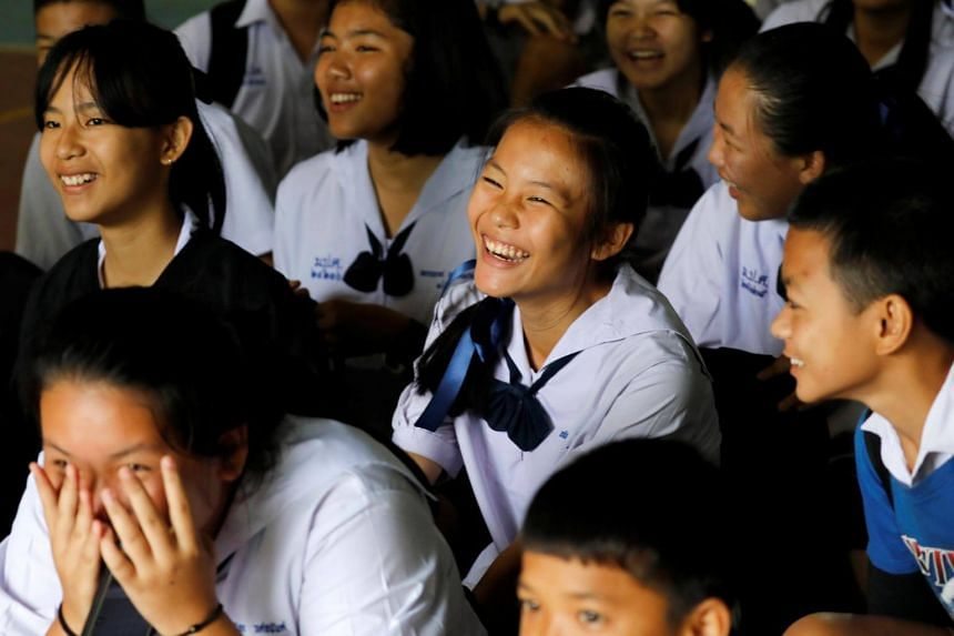 Classmates rejoicing at Mae Sai Prasitsart school after a teacher announced that some of the 12 schoolboys who were trapped inside a flooded cave have been rescued, on July 9, 2018.