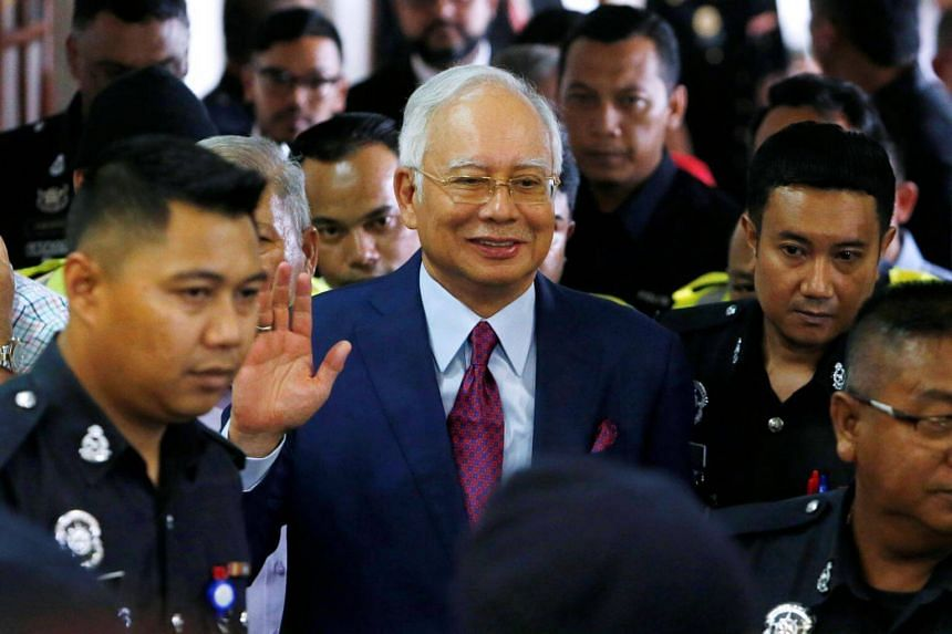 Malaysia's former prime minister Najib Razak leaves a courtroom in Kuala Lumpur, Malaysia, on July 4, 2018.