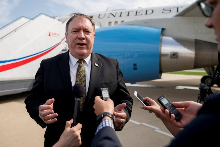 US Secretary of State Mike Pompeo speaks to members of the media before boarding his plane at Sunan International Airport in Pyongyang, on July 7, 2018.