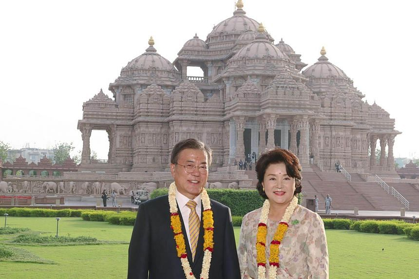 South Korean President Moon Jae In and first lady Kim Jung Sook pose for a picture at Swaminarayan Akshardham in New Delhi, on July 8, 2018.