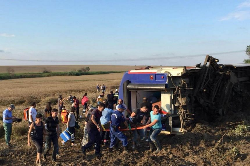 Emergency rescuers carrying victims at the site of a train accident in Tekirdag, Turkey, on July 8, 2018. Ten people died and 72 were wounded in the accident.