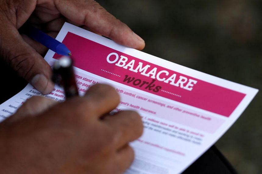 A man fills out an information card during an Affordable Care Act outreach event hosted by Planned Parenthood for the Latino community in Los Angeles, California, on  Sept, 2013.
