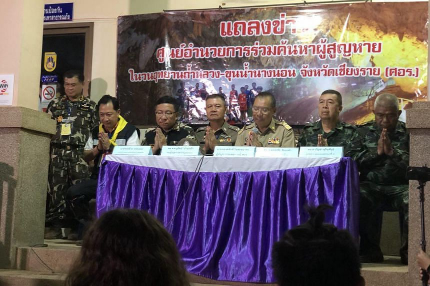 Mr Narongsak Osotthanakorn (third from right), head of the rescue mission for 12 schoolboys and their football coach trapped in Tham Luang cave, holds a press conference on July 9, 2018.