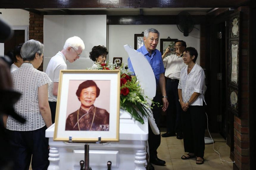 Prime Minister Lee Hsien Loong with his wife, Mrs Lee (left), and son Li Yipeng (second from left) at the wake of Mrs Wee Kim Wee on July 9, 2018.