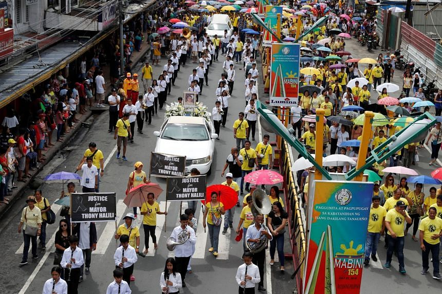 Supporters taking part in a funeral march yesterday for Mayor Antonio Halili, who was shot during a ceremony in Tanauan on Monday.