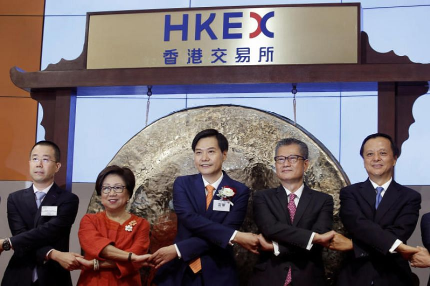 Xiaomi founder, chairman and CEO Lei Jun (centre) attends the listing of the company with Hong Kong Exchanges and Clearing (HKEX) chairman Laura Cha (2nd left), Financial Secretary Paul Chan (2nd right) and HKEX CEO Charles Li (right) on July 9, 2018