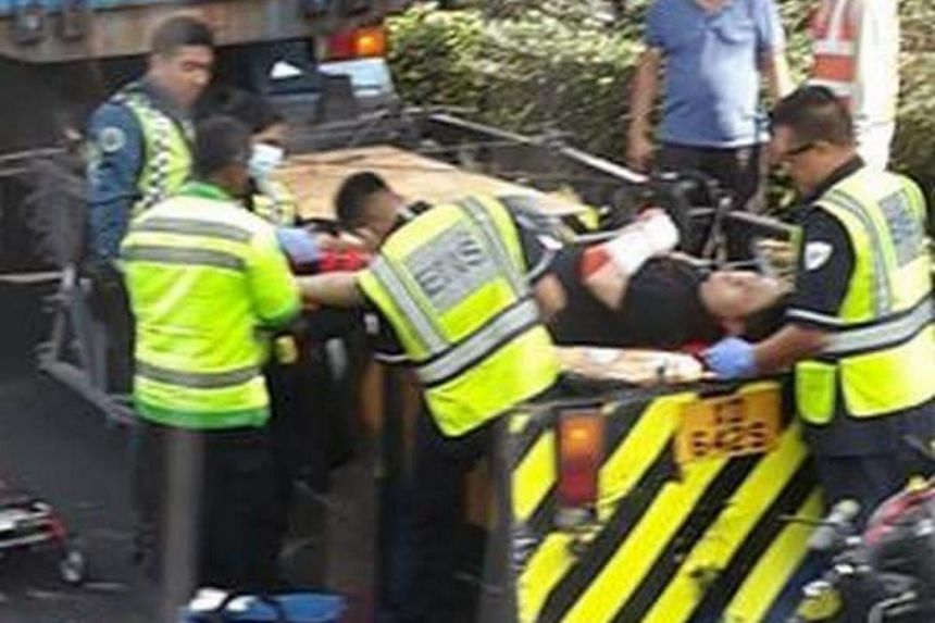 The Straits Times understands that the truck had been stationary when the 30-year-old motorcyclist collided into it.