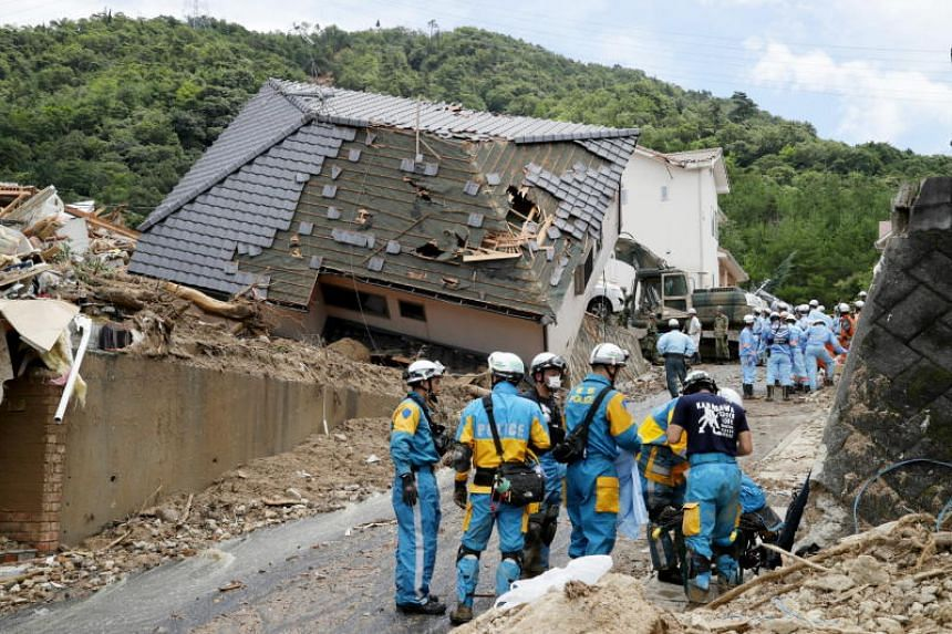 Police and fire department rescue workers prepare for searching operation in Kumano, Hiroshima Prefecture, Japan, on July 9, 2018.