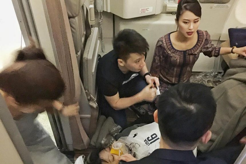 ME1 Lam and his wife Ms Chia were lauded online after they stepped forward to help an unconscious passenger on board an SIA flight to Japan last on July 6, 2018.