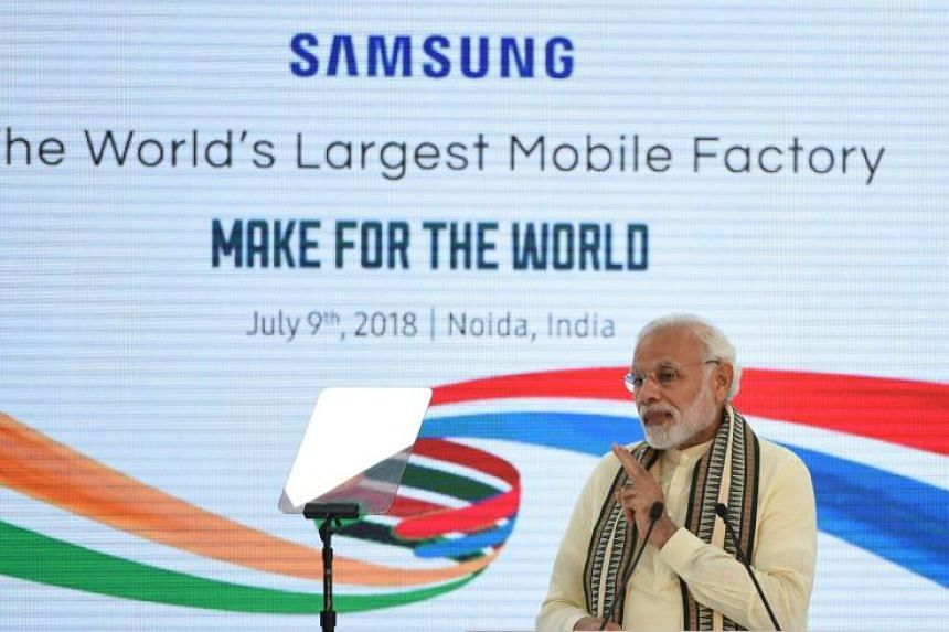 Indian Prime Minister Narendra Modi at the inauguration of the world's largest mobile factory at the Samsung India electronics private limited in Noida, on July 9, 2018.