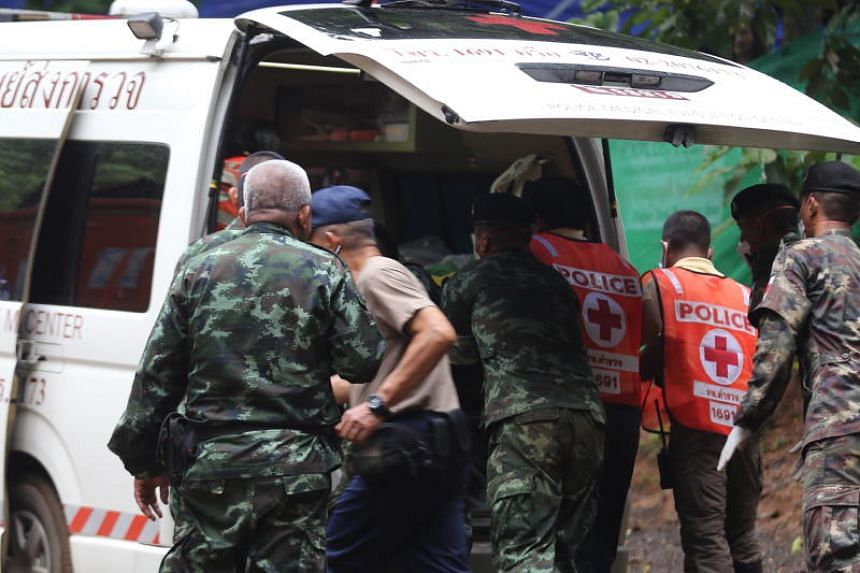 Thai authorities placing a rescued boy in an ambulance for transportation from Tham Luang cave to a hospital in Chiang Rai province on July 8, 2018.