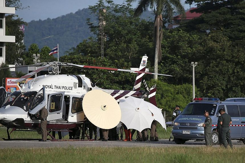 One of the rescued footballers being transferred from a Royal Thai Police helicopter to an ambulance at a military airport in Chiang Rai yesterday.