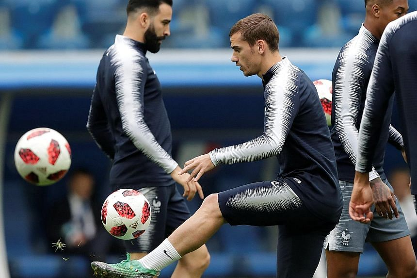 Forward Antoine Griezmann training with his team-mates ahead of today's semi-final clash with Belgium. France are aiming to reach their first final since 2006.