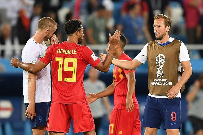 England forward Harry Kane (right) and midfielder Eric Dier catch up with Belgium's Mousa Dembele after their group-stage match. All three are team-mates at Tottenham, the EPL club with the highest representation of players in the World Cup semi-fina