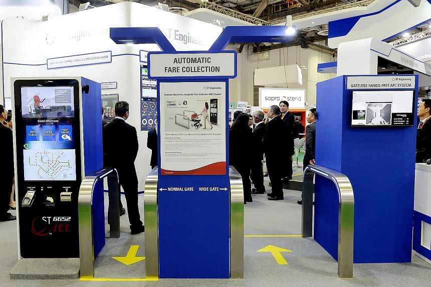 ST Engineering's automatic fare collection system, unveiled at the exhibition yesterday, does not have a physical gate. Instead, commuters carry a long-range RFID wristband, card or key-tag to walk past a gate.