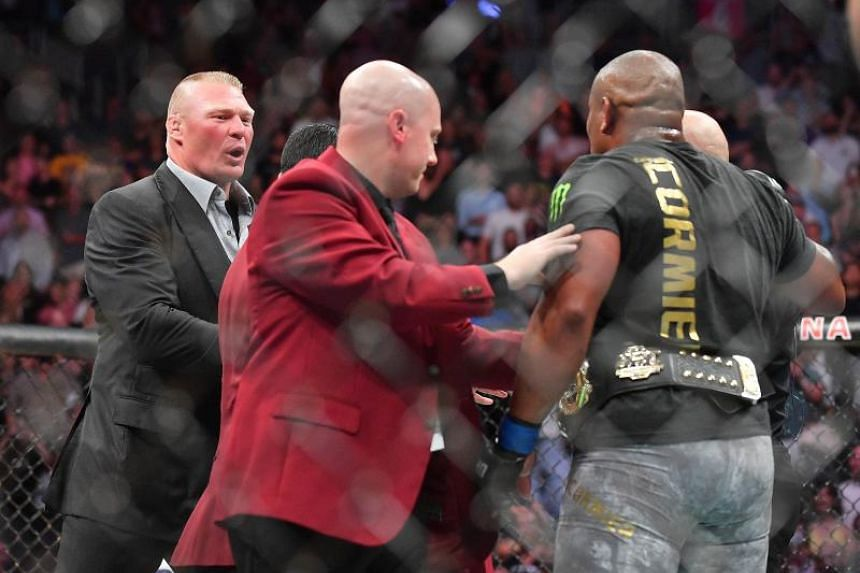 Brock Lesnar (left) confronts Daniel Cormier after his heavyweight championship fight against Stipe Miocic at T-Mobile Arena on July 7, 2018 in Las Vegas, Nevada