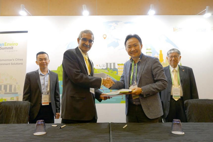 Pestech Holding founder Tong Kien Seng (front row, right) and LiveLabs Urban Lifestyle Innovation Platform director Rajesh Balan (front row, left) at the signing of a memorandum of understanding on July 10, 2018.