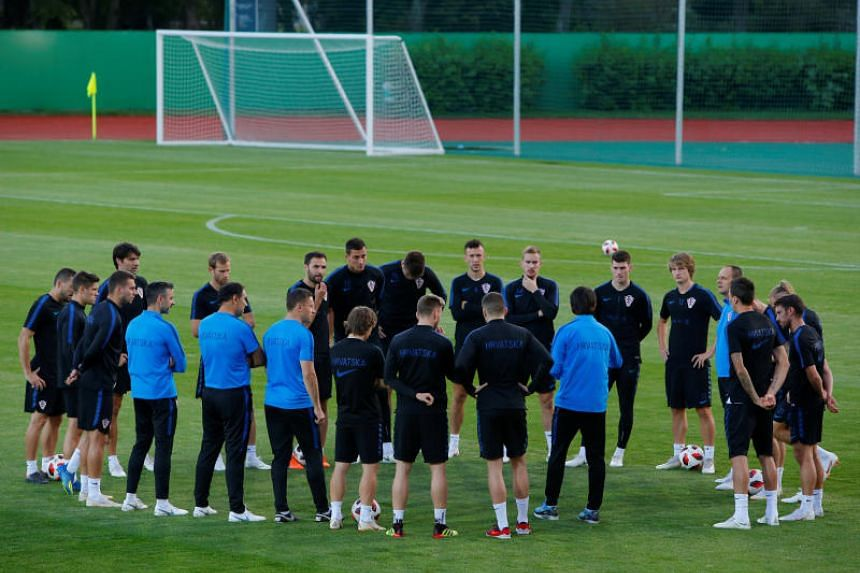 Croatia's coach Zlatko Dalic talks to players during training in Moscow on July 9, 2018.