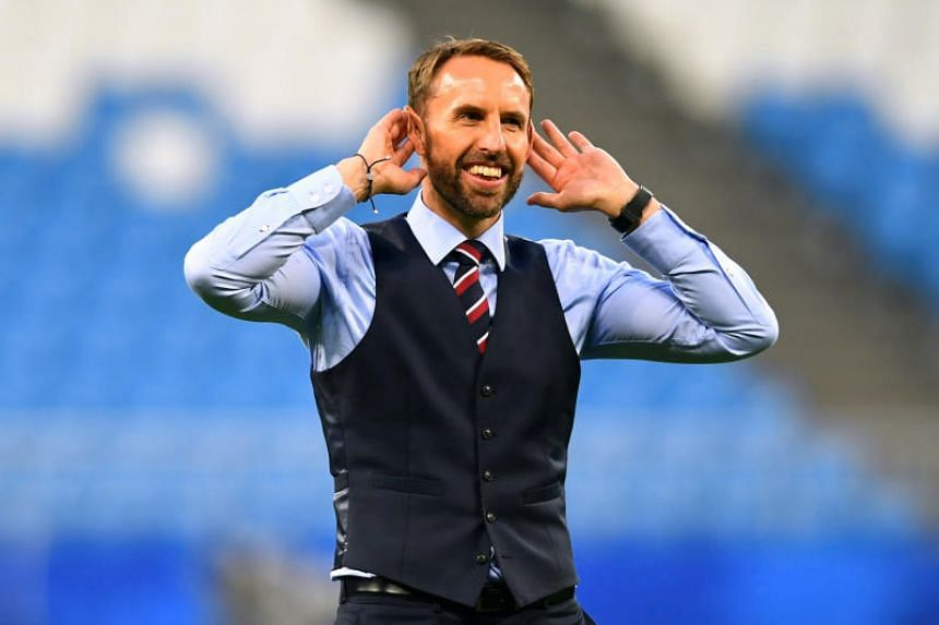 England manager Gareth Southgate salutes fans after winning the World Cup quarter-finals match against Sweden in Samara, Russia, on July 7, 2018.