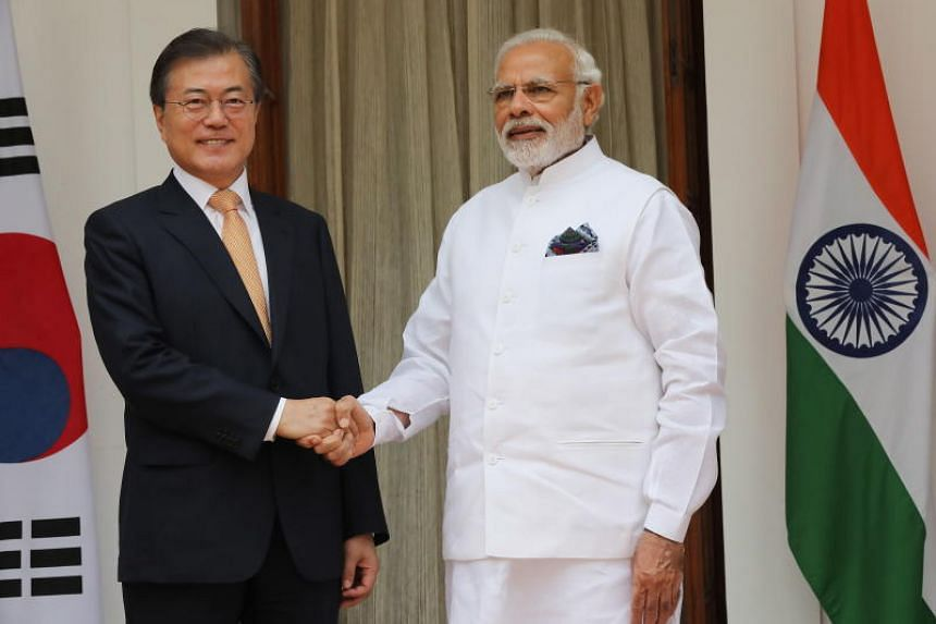 Indian prime minister Narendra Modi (right) with South Korean President Moon Jae-in shake hands prior to a meeting at Hyderabad house in New Delhi, India, on July 10, 2018.
