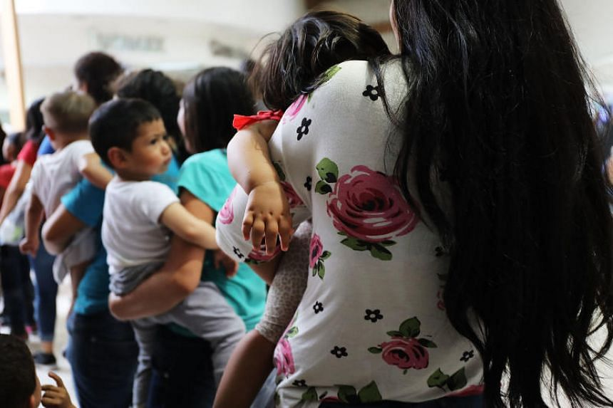 Women and their children, many fleeing poverty and violence in Honduras, Guatamala and El Salvador, arrive at a bus station following release from Customs and Border Protection in McAllen, Texas, on June 22, 2018.