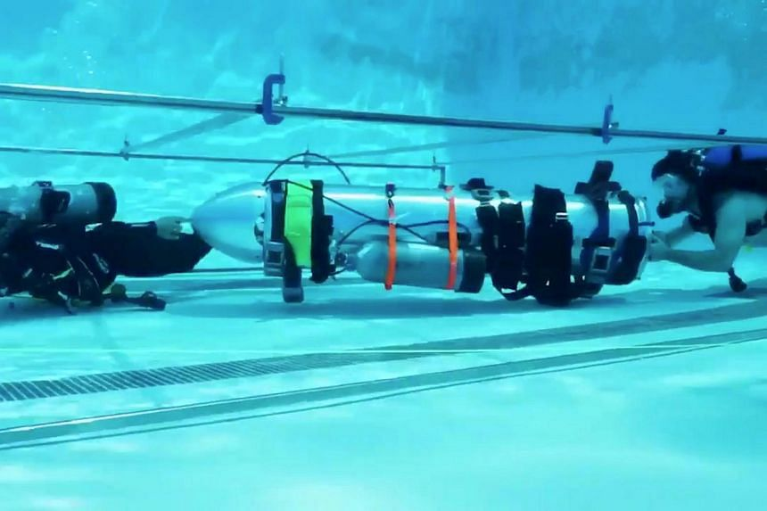 A device by Elon Musk's SpaceX and The Boring Company, designed to help rescue the remaining members of a football team trapped in a flooded cave in Chiang Rai, Thailand, being tested in a swimming pool in Los Angeles, California.