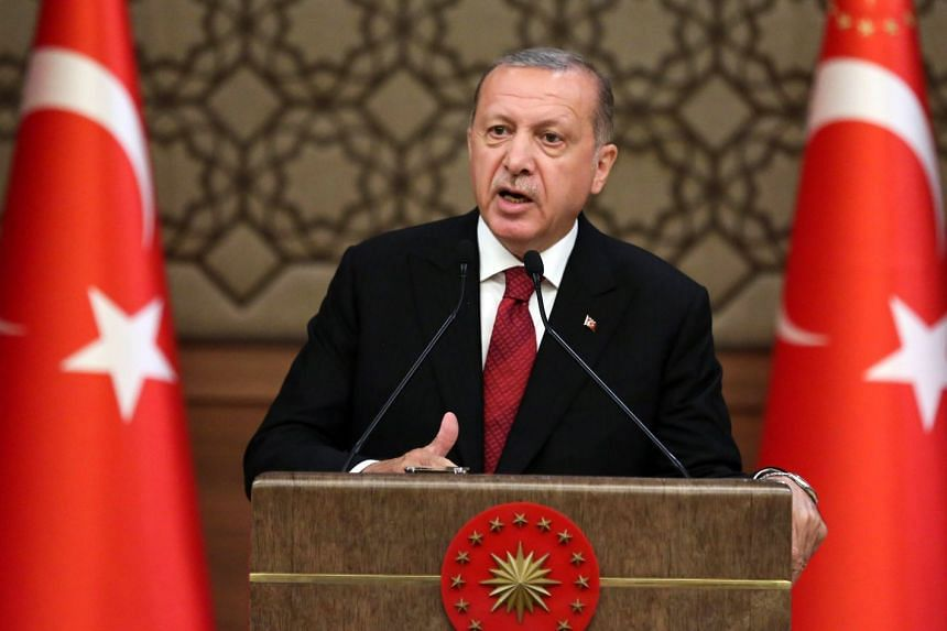 Turkish President Recep Tayyip Erdogan announces the new Turkish cabinet after taking oath as the first president under new government system in Ankara, on July 9, 2018.