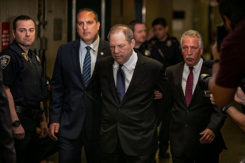 Pale and pasty faced, Harvey Weinstein was escorted by elbow into a New York courtroom in handcuffs, dressed in a dark suit, tie and white shirt.