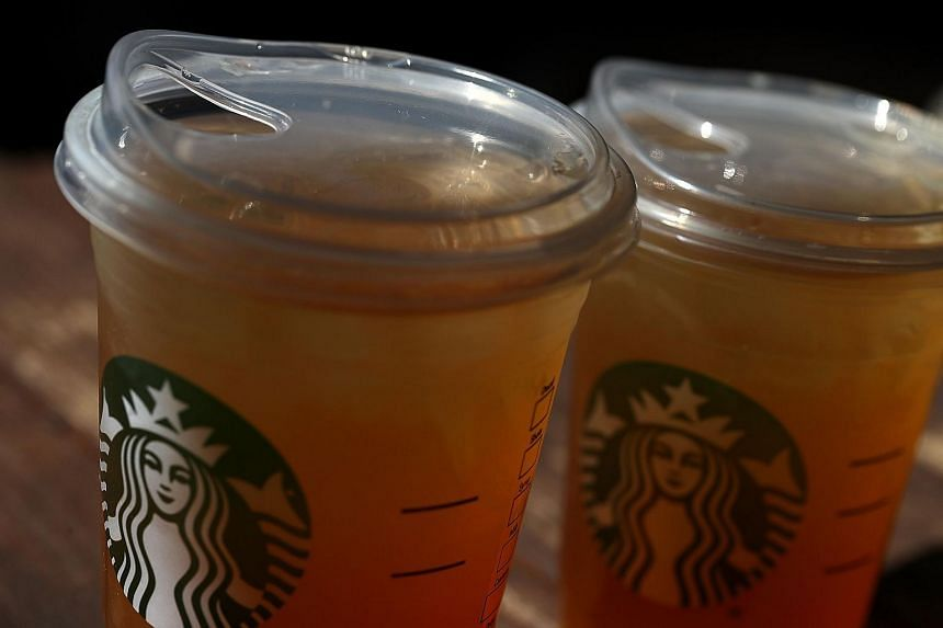 A new flat plastic lid that does not need a straw is shown on a cup of Starbucks iced tea on July 9, 2018 in Sausalito, California.