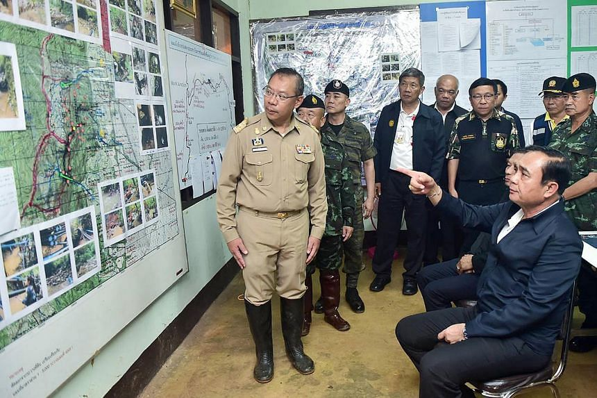 Thai Prime Minister Prayut Chan-o-cha (right) looking at a map of the Tham Luang cave as he arrives to follow up with rescue operations.