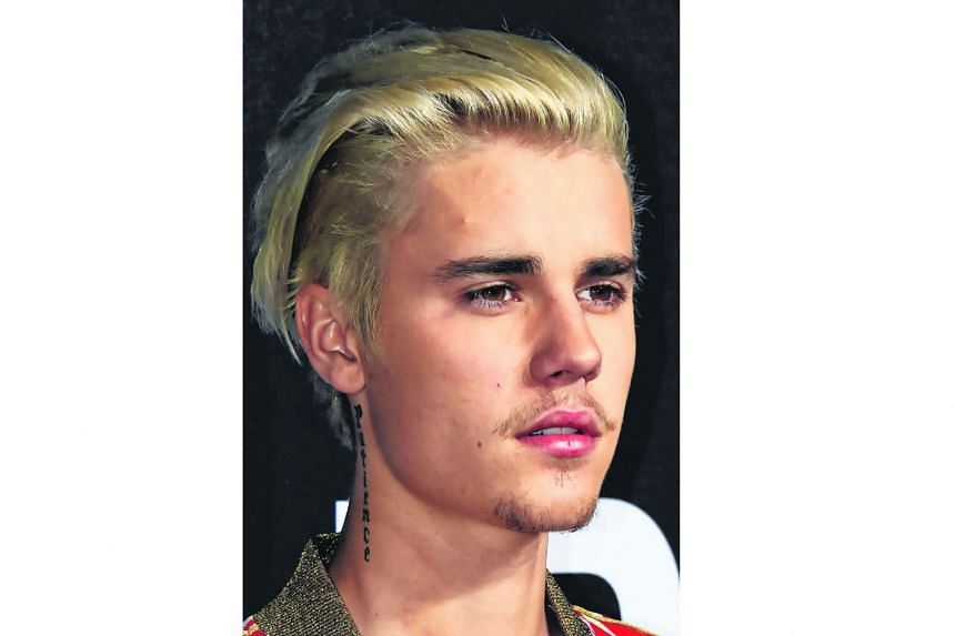 Justin Bieber (above) reportedly popped the question to Hailey Baldwin in a restaurant last Saturday.