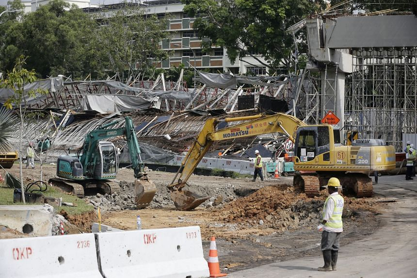 A section of the unfinished viaduct, which links the Tampines Expressway to the Pan-Island Expressway and Upper Changi Road East, collapsed on July 14 last year. The accident killed one worker and injured 10 others.