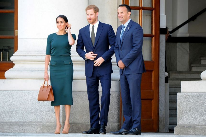 Prince Harry and his wife Meghan are welcomed by Irish Prime Minister Leo Varadkar (right).