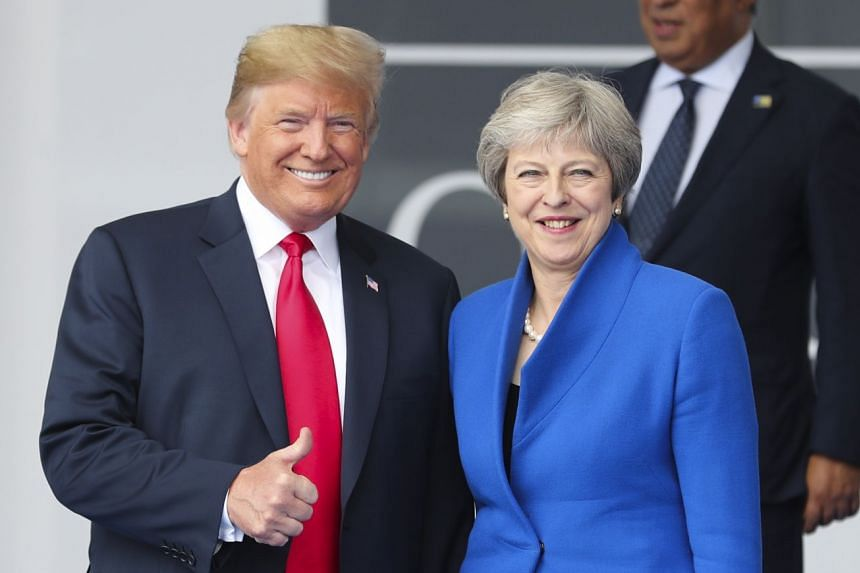 Trump and May stand together as they gather for a family photo during a Nato summit in Brussels, Belgium.
