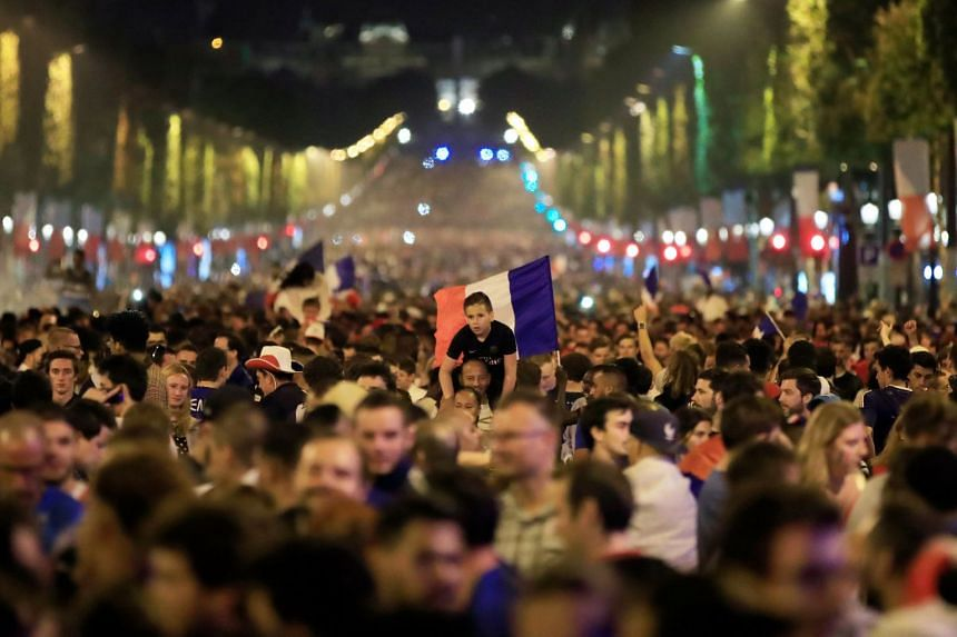 France fans react on the Champs-Elysees after defeating Belgium.