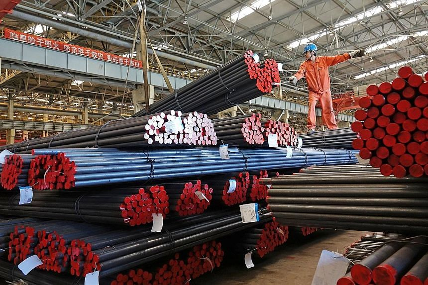 Steel bars at a warehouse in Dalian, Liaoning province. The jump in prices of resources such as steel has benefited producers but raised input costs for manufacturers like exporters.