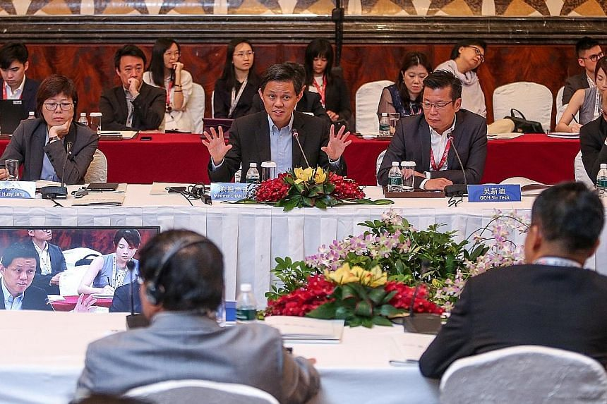 From left: Singapore Press Holdings' Chinese Media Group head Lee Huay Leng, Trade and Industry Minister Chan Chun Sing, and Lianhe Zaobao and Lianhe Wanbao editor Goh Sin Teck at the Singapore-China Forum.