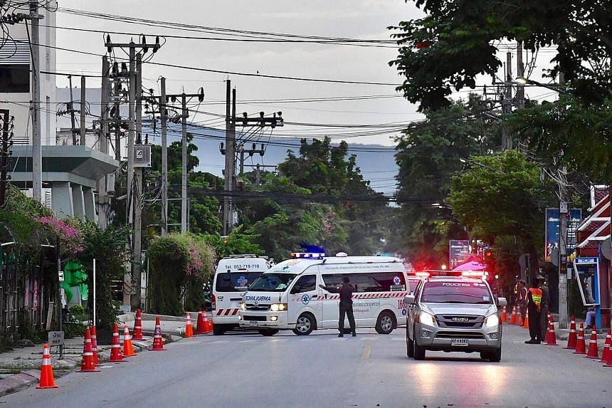 An ambulance with a rescued boy arriving at the Chiang Rai hospital yesterday. Jubilant Thais poured into the streets of Chiang Rai, honking car horns and taking selfies, as news arrived that the remaining members of the team had been taken alive and