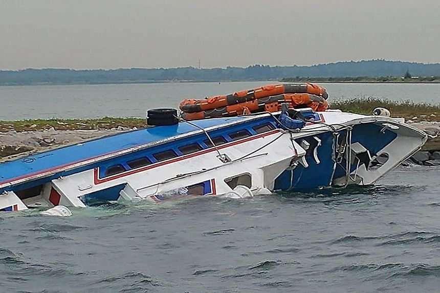The Indonesian-flagged ferry Sri Kandi 99 ran aground on rocks at the southern tip of Pulau Tekong on Monday night. Singapore Police Coast Guard officers used night-vision technology and searchlights and found five people stuck in the ferry, which wa