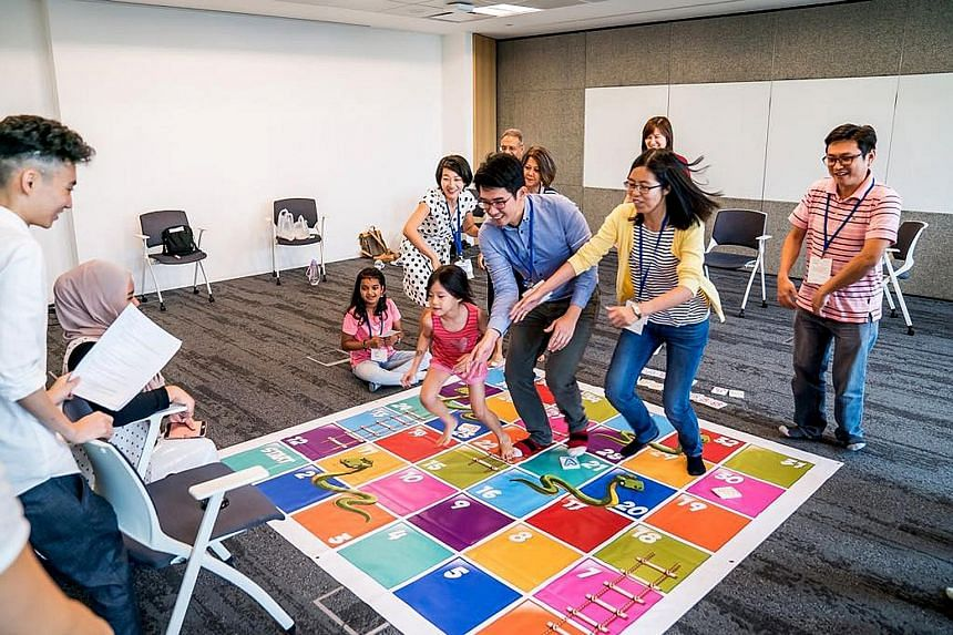 Above: Participants enjoying a life-sized board game designed for people to learn about mental wellness during A Good Day, an event organised by A Good Space. Left: Mr Dexter Tai, one of the changemakers who have benefited from A Good Space. With its