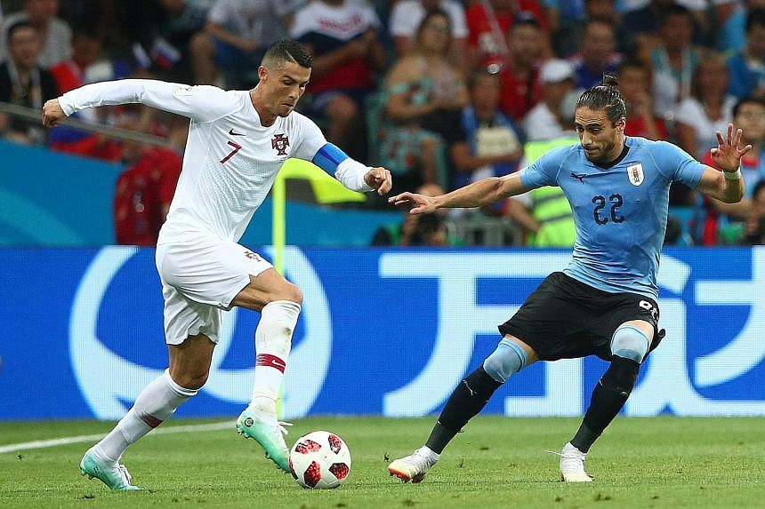 Uruguay's Martin Caceres (right) shows that he is unfazed by the challenge of going against one of the best players in the world in Portugal's Cristiano Ronaldo during their last-16 clash.