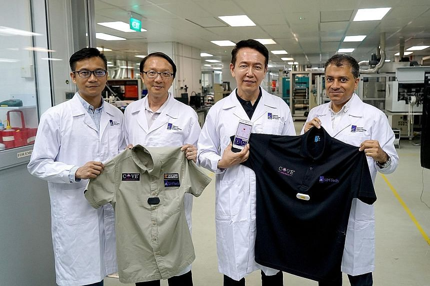 The team behind the smart shirt comprises (from left) Mr Justin Tan, Tex Line's product manager; Mr Lok Boon Keng, principal research engineer at SIMTech; Mr Rick Yeo, director of Emerging Applications Centre at SIMTech; and Mr Pawan Gandhi, CEO of K