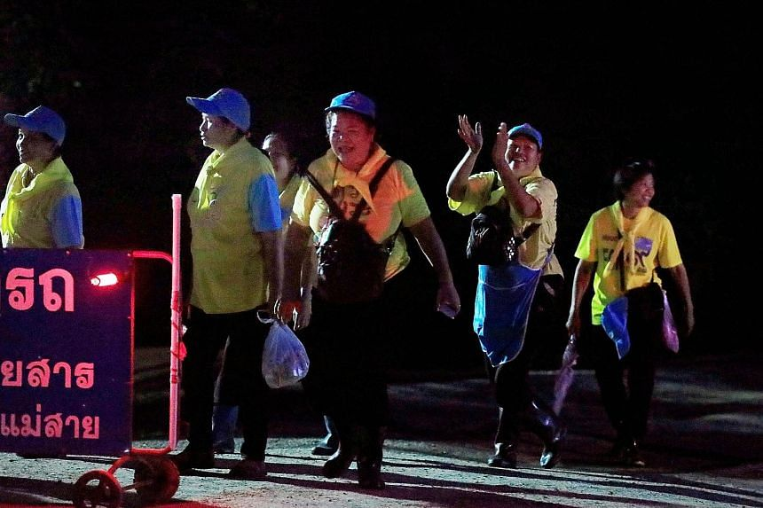 [(QUOTE_RULE)]Volunteers near the Tham Luang cave complex in Chiang Rai celebrating the successful rescue work yesterday. The restrictions placed by the authorities on access to the cave did not stop people from stepping up as volunteers - some offer